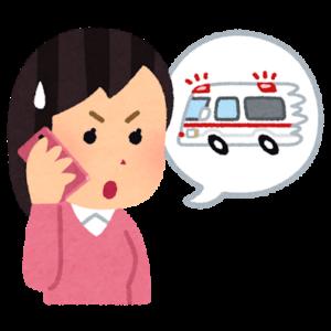 救急車を呼ぶ女性